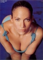 Jennifer Lopez posing in a blue sexy swimming suite