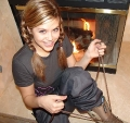 Teen Topanga striping off by the fireplace