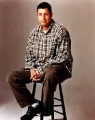 Adam Sandler sitting