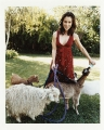 Alyssa Milano with goats on the countryside