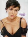 Alyssa Milano wearing black bra