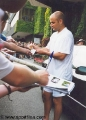 Andre Agassi giving autographs
