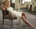 Anna Kournikova sitting on an armchair