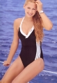 Anna Kournikova in black adidas swimming siute with white stripes