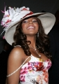 Ashanti wearing big hat