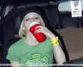 Avril Lavigne is drinking vodka from plastic cups