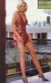 Cameron Diaz with outstanding legs is posing on a balcony