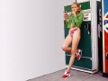 Cameron Diaz by the Pepsi machine showing her great legs