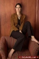 Carrie Anne Moss in brown jacket