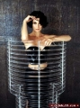 Carrie Anne Moss in silver tube