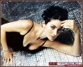 Carrie Anne Moss laying on the floor