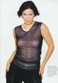 Carrie Anne Moss wearing transparent shimmy