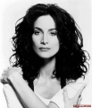 Carrie Anne Moss with curly hair