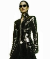 Carrie Anne Moss posing in sexy leather suit