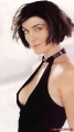 Carrie Anne Moss in black dress