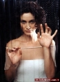 Carrie Anne Moss behind the glass