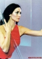 Carrie Anne Moss posing in red dress