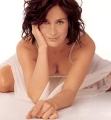 Carrie Anne Moss wearing sexy lingerie