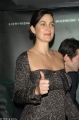 Carrie Anne Moss in sexy dress with hot neckline