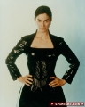 Carrie Anne Moss wearing black leather