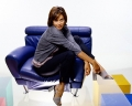 Catherine Bell sitting in a blue leather armchair
