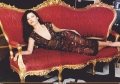 Glamorous Catherine Zeta Jones laying on a stylish couch
