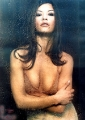 Catherine Zeta Jones posing behind the wet glass