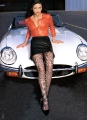 Catherine Zeta Jones showing her outstanding lags by the stylish Jaguar
