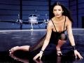 Catherine Zeta Jones posing inside aeroplane hangar