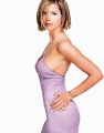Charisma Carpenter in tight violet dress