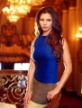 Charisma Carpenter in blue dress