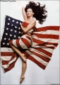 Charisma Carpenter entwined with USA Flag