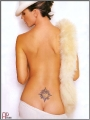 Charisma Carpenter showing her naked back decorated with tatoo