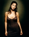 Charisma Carpenter in sexy dress divulging her nackline