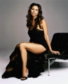 Charisma Carpenter wearing beautiful black dress divulging her legs