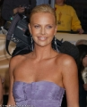 Charlize Theron in violet dress with plunging neckline