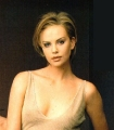 Charlize Theron showing plunging neckline
