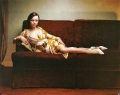 Christina Ricci in glamorous dress is sitting on stylish couch