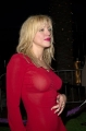 Courtney Love in red tight dress