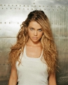 Denise Richards posing in white shimmy