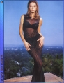 Denise Richards posing on the rooftop in great dress
