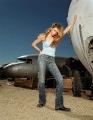 Denise Richards posing at the junkyard