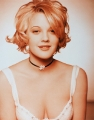 Drew Barrymore in white shirt with plunging neckline