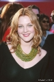 Drew Barrymore wearing black dress with plunging neckline
