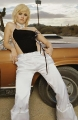 Elisha Cuthbert posing next to muscle car