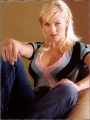 Elisha Cuthbert wearing blouse with plunging neckline