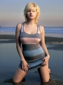 Elisha Cuthbert posing on the beach at the sunset