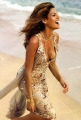 Eva Mendes wearing golden dress on the windy beach