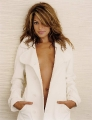 Cute Eva Mendes wearing sexy white coat