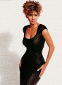 Curly haired Halle Berry wearing sexy black dress
